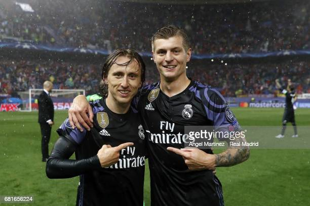 Luka Modric and Toni Kroos of Real Madrid celebrate after the UEFA Champions League Semi Final second leg match between Club Atletico de Madrid and...