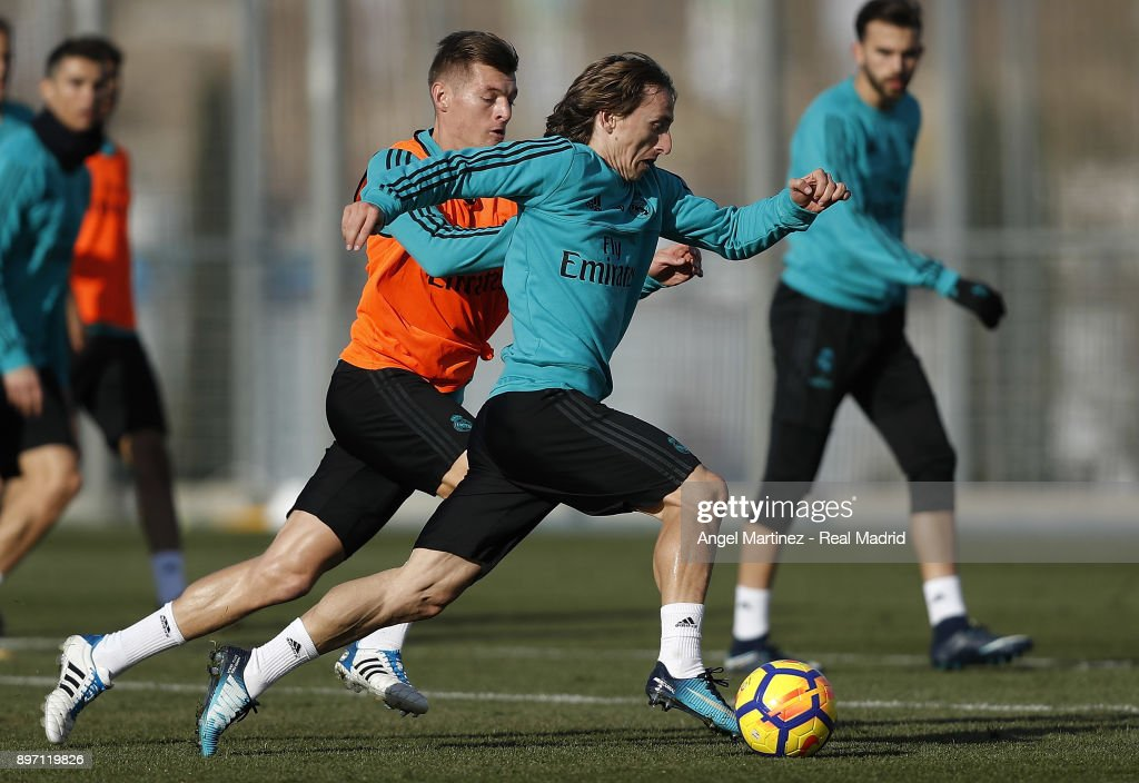 Luka Modric (R) and Toni Kroos of Real Madrid in action during a training session at Valdebebas training ground on December 22, 2017 in Madrid, Spain.