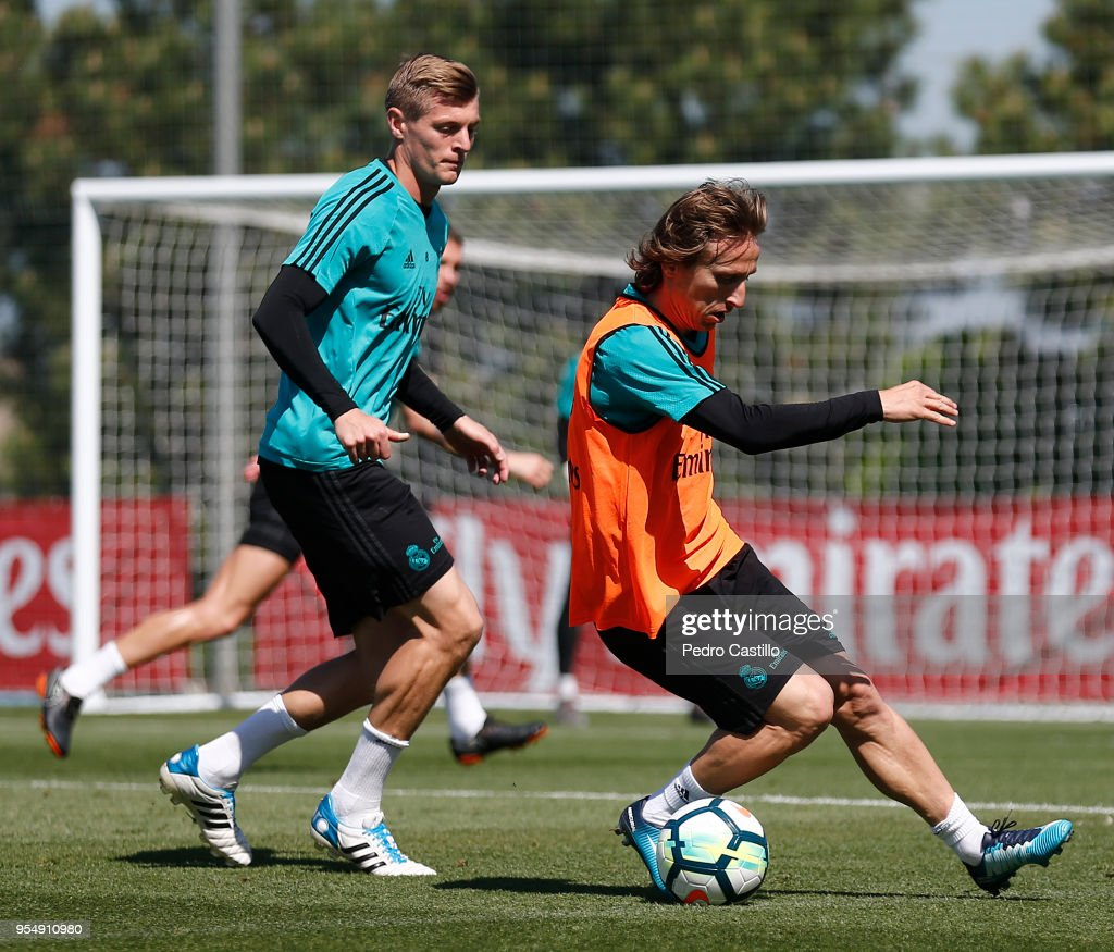 Luka Modric (R) and Toni Kroos of Real Madrid in action during a training session at Valdebebas training ground on May 5, 2018 in Madrid, .