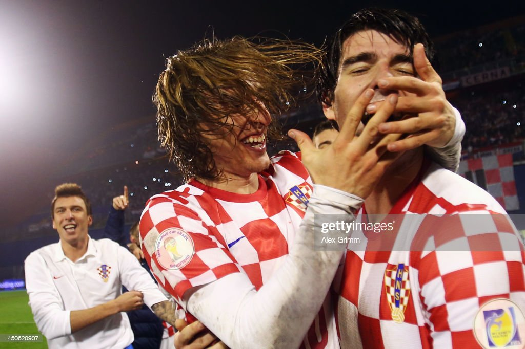 Luka Modric (L) and Vedran Corluka of Croatia celebrate after the FIFA 2014 World Cup Qualifier play-off second leg match between Croatia and Iceland at Maksimir Stadium on November 19, 2013 in Zagreb, Croatia.