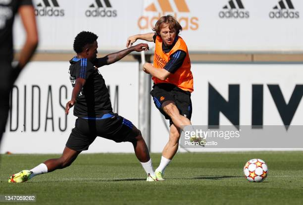 Luka Modric and Vini Jr. Both of Real Madrid during training at Valdebebas training ground on October 17, 2021 in Madrid, Spain.