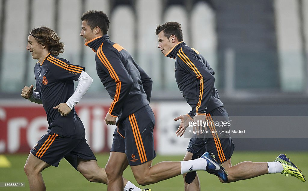 Luka Modric, Cristiano Ronaldo and Gareth Bale of Real Madrid run during a training session ahead of their UEFA Champions League Group B match against Juventus at Juventus Arena on November 4, 2013 in Turin, Italy.