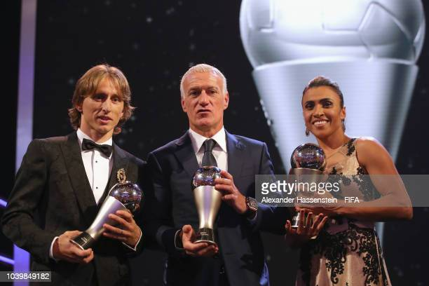 Luka Modric Didier Deschamps and Marta pose for a photo with their awards during The Best FIFA Football Awards at Royal Festival Hall on September 24...