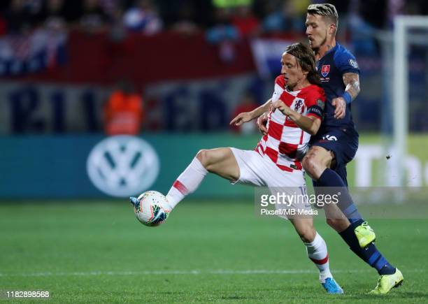 Luka Modric from Croatia and Juraj Kucka from Slovakia during the UEFA Euro 2020 Qualifier between Croatia and Slovakia on November 16, 2019 in...
