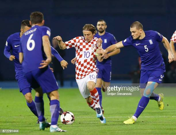Luka Modric in action against Alexandros Tziolis and Kyriakos Papadopoulos of Greece during the FIFA 2018 World Cup Qualifier PlayOff First Leg...
