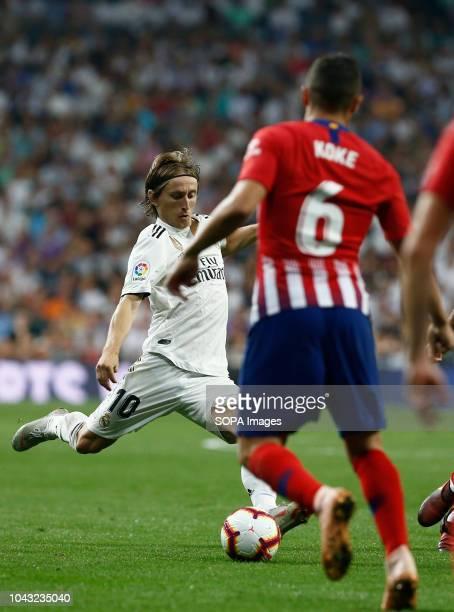 Luka Modric in action during the La Liga match between Real Madrid and Club Atletico de Madrid at Estadio Santiago Bernabéu in Madrid, Spain .