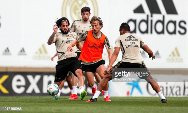 Luka Modric , Isco and Casemiro of Real Madrid during a during a training session at Valdebebas training ground on June 2, 2020 in Madrid, Spain.