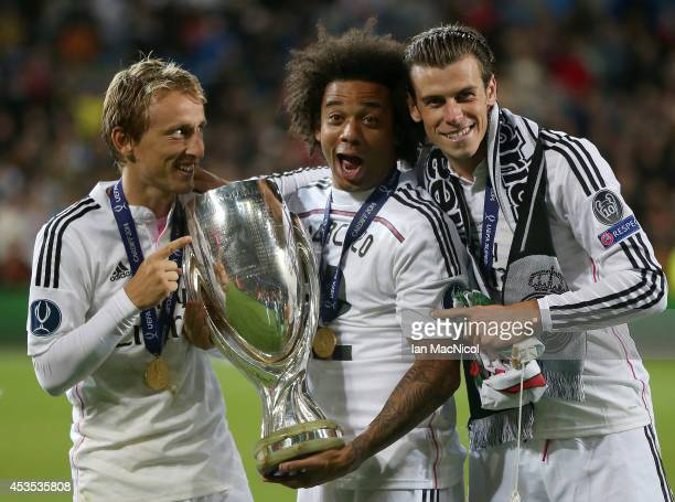 Luka Modric Marcelo and Gareth Bale of Real Madrid pose with the trophy during the UEFA Super Cup match between Real Madrid and Sevilla at Cardiff...