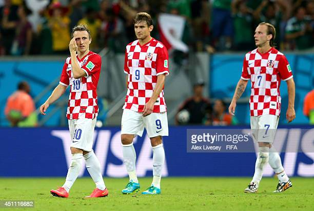 Luka Modric Nikica Jelavic and Ivan Rakitic of Croatia show their dejection after conceding the third goal to Mexico during the 2014 FIFA World Cup...