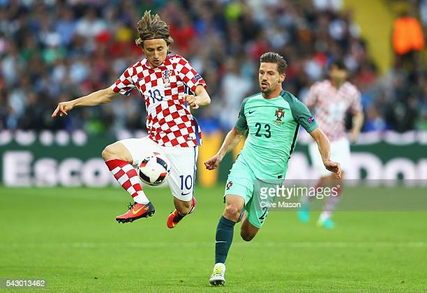 Luka Modric of Croatia and Adrien Silva of Portugal compete for the ball during the UEFA EURO 2016 round of 16 match between Croatia and Portugal at...