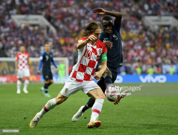 Luka Modric of Croatia and Blaise Matuidi of France compete for the ball during the 2018 FIFA World Cup Final between France and Croatia at Luzhniki...