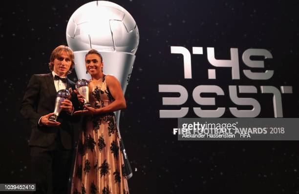 Luka Modric of Croatia and Real Madrid and Marta of Brazil and Orlando Pride pose for a photo with their awards during The Best FIFA Football Awards...