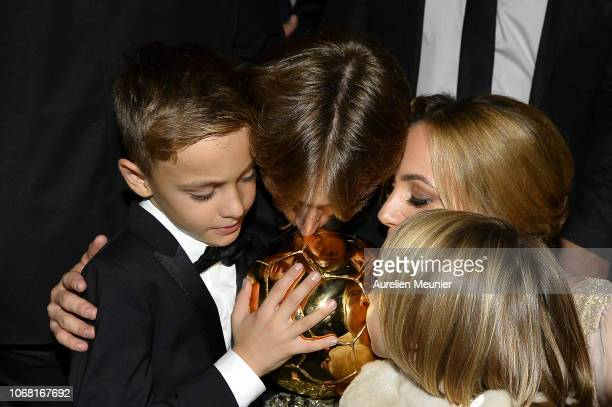 Luka Modric of Croatia and Real Madrid kiss the trophy with his wife Vanja Bosnic and their children Ivano and Ema after he won the 2018 Ballon D'Or...