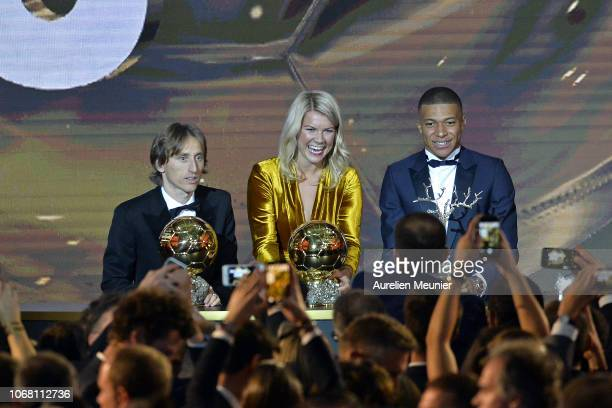 Luka Modric of Croatia and Real Madrid Kylian Mbappe of £France and Paris SaintGermain and Ada Hegerberg of Sweden and Olympioque Lyonnais pose with...