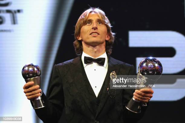 Luka Modric of Croatia and Real Madrid pose for a photo with his The Best FIFA Men's Player Award and FIFA FIFPro World11 award during The Best FIFA...