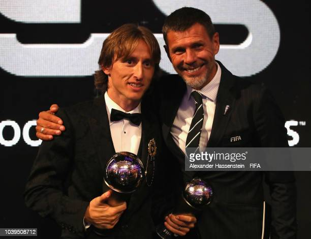 Luka Modric of Croatia and Real Madrid pose for a photo with Zvonimir Boban, FIFA Deputy Secretary General after The Best FIFA Football Awards at...