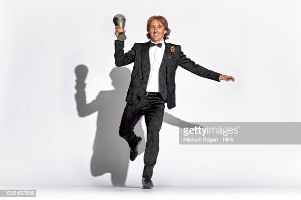 Luka Modric of Croatia and Real Madrid pose for a picture with his The Best FIFA Men's Player Award during The Best FIFA Football Awards at Royal...