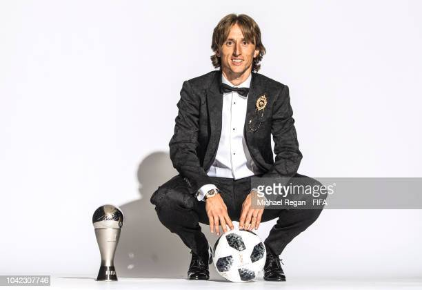 Luka Modric of Croatia and Real Madrid poses for a photo with his The Best FIFA Men's Player Award during The Best FIFA Football Awards at Royal...