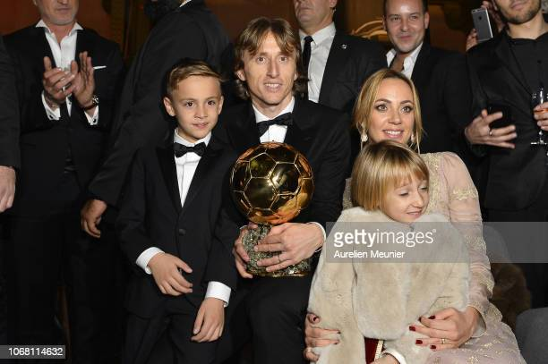 Luka Modric of Croatia and Real Madrid poses with his wife Vanja Bosnic and their children Ivano and Ema after winning the 2018 Ballon D'Or at Le...