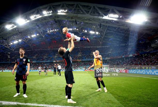 Luka Modric of Croatia celebrates with Domagoj Vida of Croatia's son following Croatia's victory in the 2018 FIFA World Cup Russia Quarter Final...