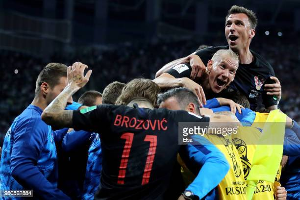 Luka Modric of Croatia celebrates with team mates after scoring his team's second goal during the 2018 FIFA World Cup Russia group D match between...