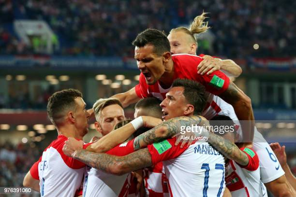 Luka Modric of Croatia celebrates with teammates after scoring his team's second goal during the 2018 FIFA World Cup Russia group match between...