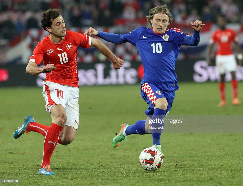 Luka Modric of Croatia (R) challenges Admir Mehmedi of Switzerland (L) during the international friendly match between Switzerland and Croatia at the AFG Arena on March 5, 2014 in St Gallen, Switzerland.