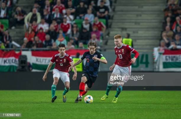 Luka Modric of Croatia competes for the ball with Adam Nagy of Hungary during the Hungary and Croatia European Qualifying match at Groupama stadium...