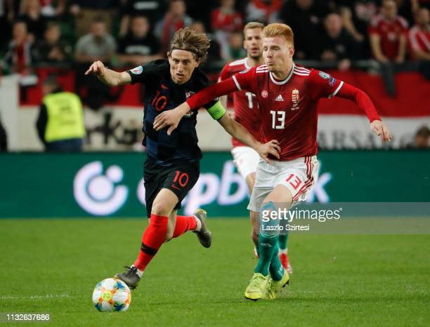 Luka Modric of Croatia competes for the ball with Zsolt Kalmar of Hungary during the 2020 UEFA European Championships group E qualifying match...