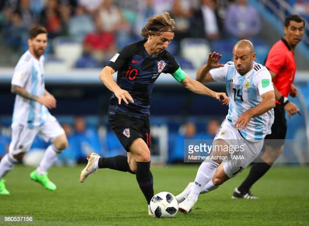 Luka Modric of Croatia competes with Javier Mascherano of Argentina during the 2018 FIFA World Cup Russia group D match between Argentina and Croatia...