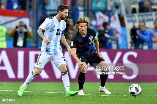 Luka Modric of Croatia competes with Lionel Messi of Argentina during the 2018 FIFA World Cup Russia group D match between Argentina and Croatia at...