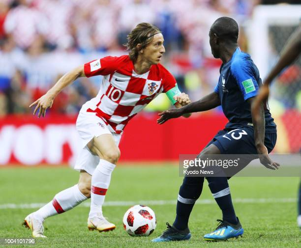 Luka Modric of Croatia dribbles the ball near Ngolo Kante of France during the first half of the World Cup final at Luzhniki Stadium in Moscow on...
