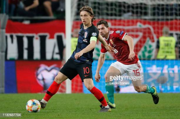 Luka Modric of Croatia drives the ball past Mate Patkai of Hungary during the 2020 UEFA European Championships group E qualifying match between...
