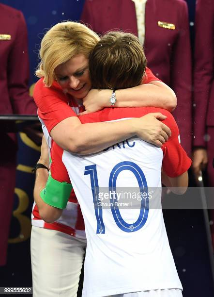 Luka Modric of Croatia embraces Kolinda GrabarKitarovic President of Croatia following the 2018 FIFA World Cup Final between France and Croatia at...