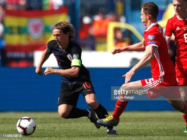 Luka Modric of Croatia fights for a ball with James Lawrence of Wales during the 2020 UEFA European Championships group E qualifying match between...