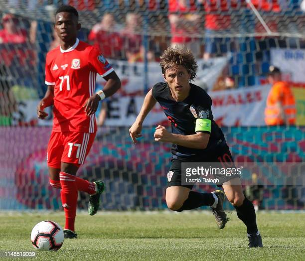 Luka Modric of Croatia fights for a ball with Rabbi Matondo of Wales during the 2020 UEFA European Championships group E qualifying match between...