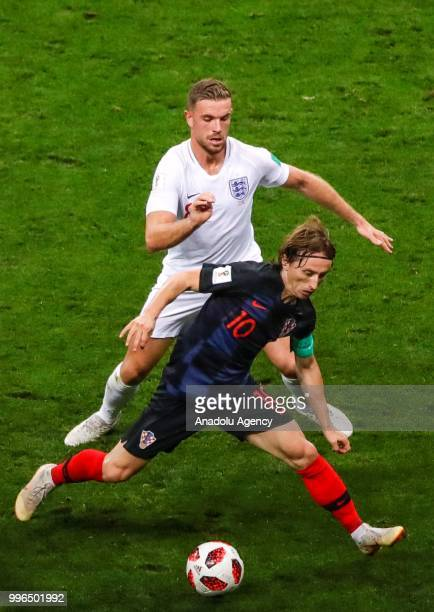 Luka Modric of Croatia in action against Jordan Henderson of England during the 2018 FIFA World Cup Russia Semi Final match between England and...
