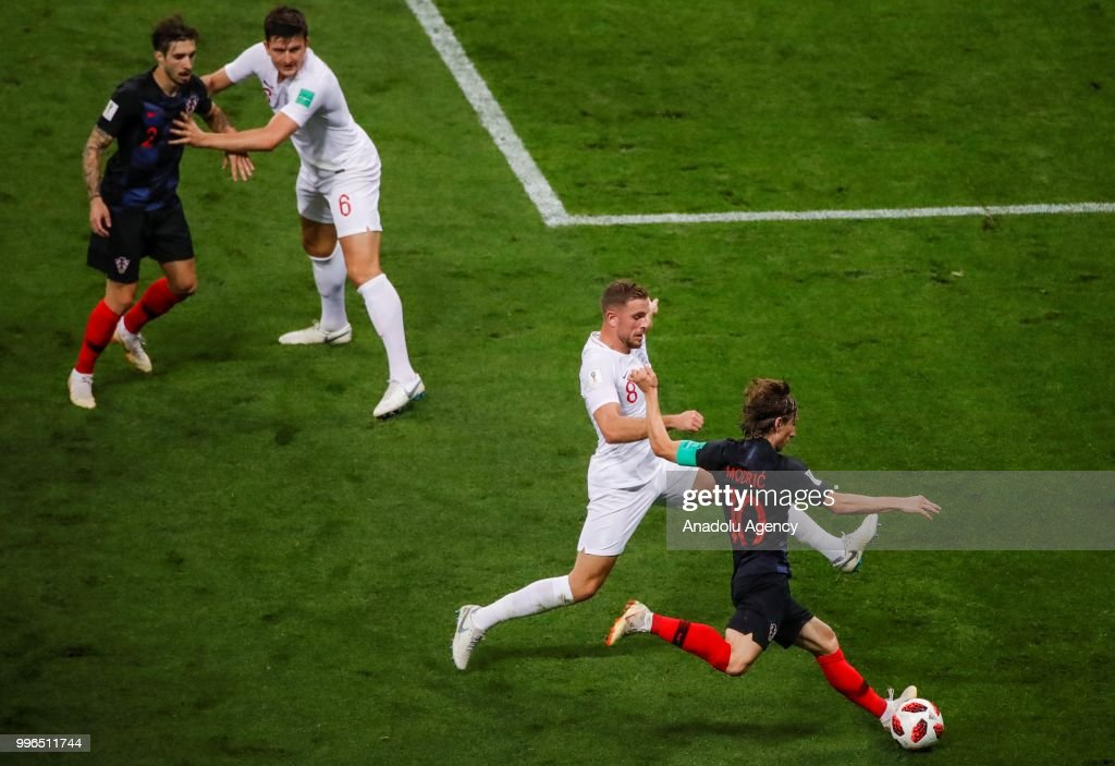 Luka Modric (10) of Croatia in action against Jordan Henderson (8) of England during the 2018 FIFA World Cup Russia Semi Final match between England and Croatia at Luzhniki Stadium on July 11, 2018 in Moscow, Russia. Croatia have advanced to their first ever World Cup final after beating England 2-1.