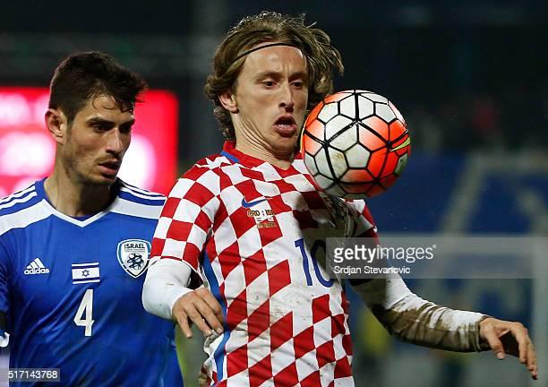 Luka Modric of Croatia in action against Nir Bitton of Israel during the International Friendly match between Croatia and Israel at stadium Gradski...