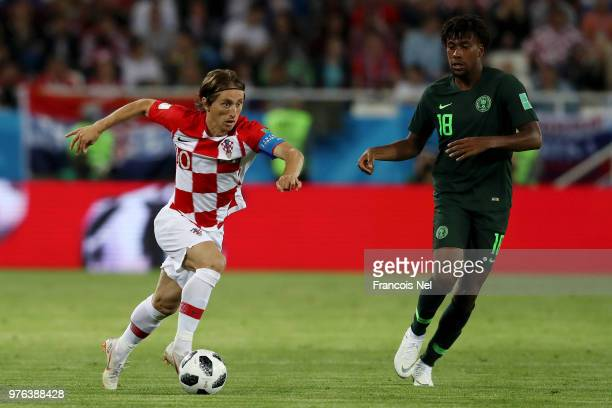 Luka Modric of Croatia is challenged by Alex Iwobi of Nigeria during the 2018 FIFA World Cup Russia group D match between Croatia and Nigeria at...