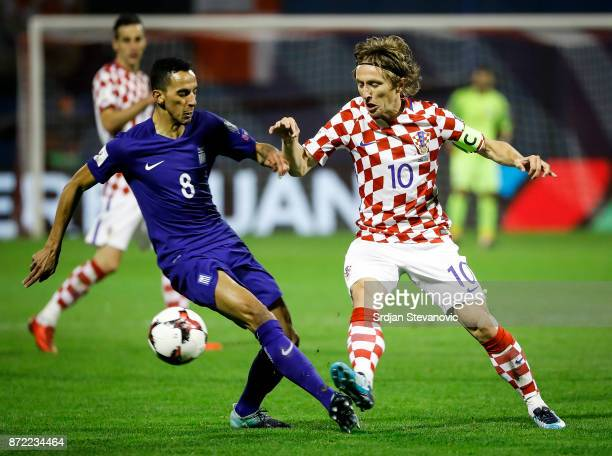 Luka Modric of Croatia is challenged by Zeca of Greece during the FIFA 2018 World Cup Qualifier PlayOff First Leg between Croatia and Greece at...