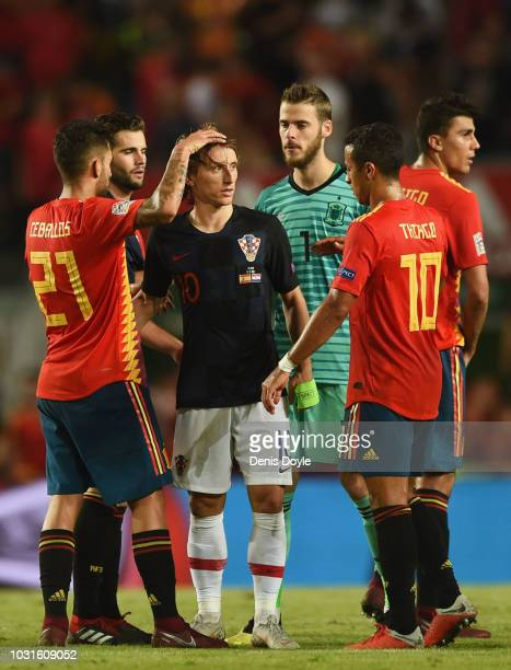 Luka Modric of Croatia is consoled by Spain players in defeat the UEFA Nations League A Group four match between Spain and Croatia at Estadio Manuel...