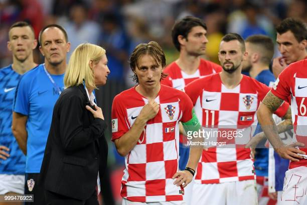 Luka Modric of Croatia is consoled following the 2018 FIFA World Cup Final between France and Croatia at Luzhniki Stadium on July 15 2018 in Moscow...
