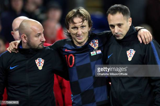 Luka Modric of Croatia is escorted off the pitch after suffering an injury during the UEFA Euro 2020 qualifier between Wales and Croatia at Cardiff...