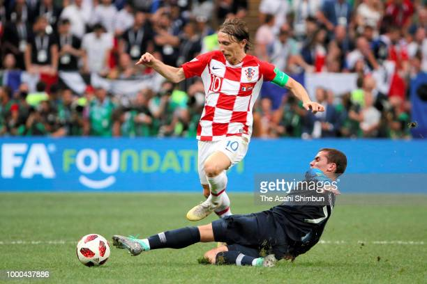 Luka Modric of Croatia is tackled by Antoine Griezmann of France during the 2018 FIFA World Cup Russia Final between France and Croatia at Luzhniki...