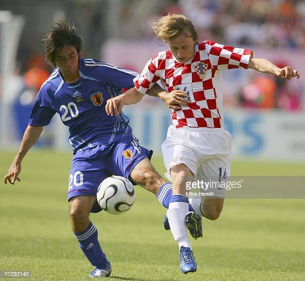 Luka Modric of Croatia is tackled by Keiji Tamada of Japan during the FIFA World Cup Germany 2006 Group F match between Japan and Croatia at the...