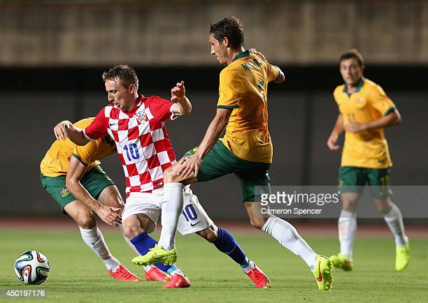 Luka Modric of Croatia is tackled by Mark Milligan of the Socceroos during the International Friendly match between Croatia and the Australian...