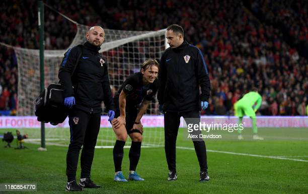 Luka Modric of Croatia leaves the field with an injury during the UEFA Euro 2020 qualifier between Wales and Croatia at Cardiff City Stadium on...