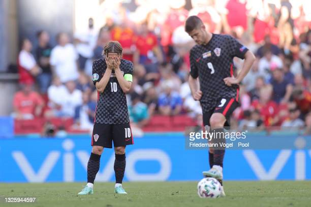 Luka Modric of Croatia looks dejected after the Spain third goal scored by Ferran Torres during the UEFA Euro 2020 Championship Round of 16 match...