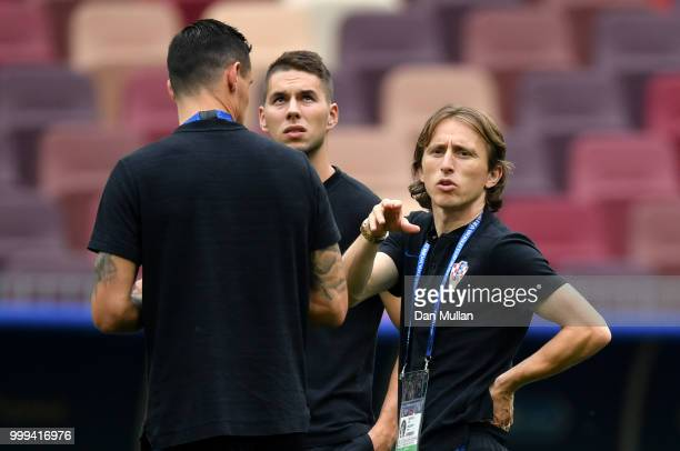 Luka Modric of Croatia looks on during a pitch inspection prior to the 2018 FIFA World Cup Final between France and Croatia at Luzhniki Stadium on...